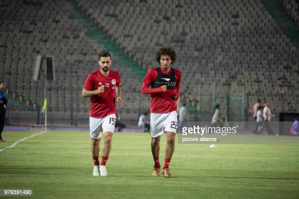 dpatop Egypt's Abdallah ElSaid and Amr warda warm up during a training session for Egypt's National soccer team in preparation for the 2018 World Cup...