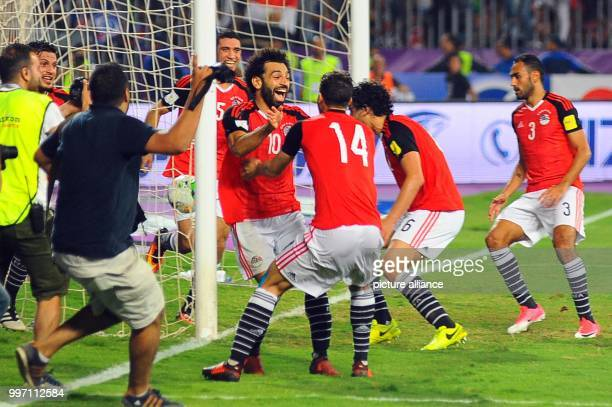 dpatop Egypt's forward Mohamed Salah celebrates with teammates after scoring his side's second goal during the FIFA 2018 World Cup qualifying match...
