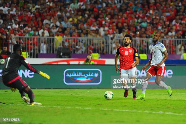 dpatop Egypt's forward Mohamed Salah scores his side's second goal during the FIFA 2018 World Cup qualifying match between the Democratic Republic of...