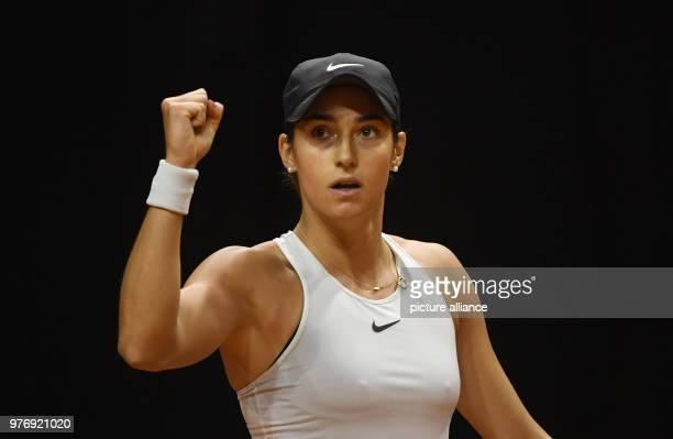 dpatop French tennis player Caroline Garcia celebrates wining a point against Ukrainian Marta Kostyuk during their 2018 Stuttgart Open round of 16...
