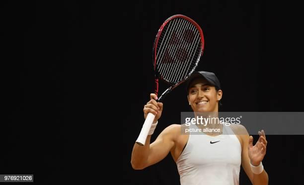 dpatop French tennis player Caroline Garcia celebrates wining against Ukrainian Marta Kostyuk during their 2018 Stuttgart Open round of 16 women's...