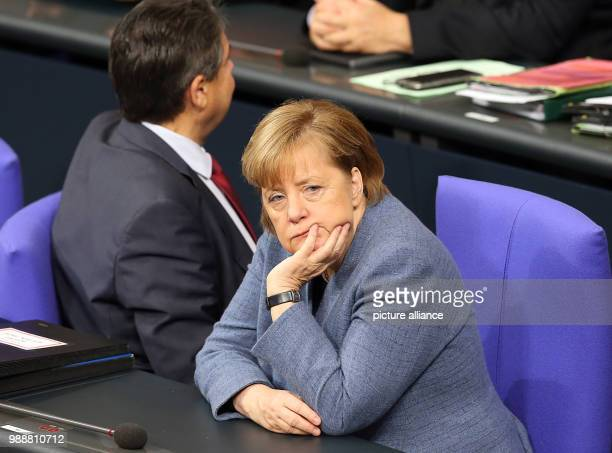Dpatop - German Chancellor Angela Merkel and Foreign Minister Sigmar Gabriel attend a session of the lower house of parliament at the Bundestag in...
