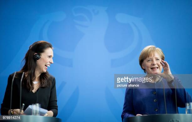 dpatop German Chancellor Angela Merkel and New Zealand's Prime Minister Jacinda Ardern hold a joint press conference following their meeting at the...
