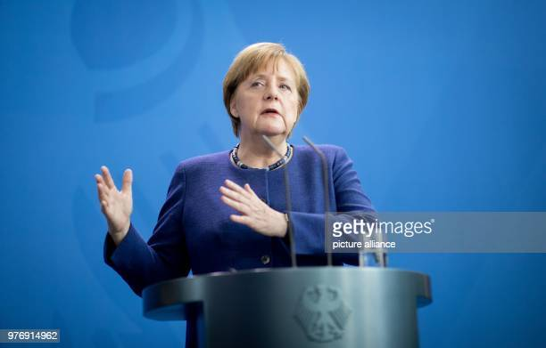 dpatop German Chancellor Angela Merkel speaks during a joint press conference with New Zealand's Prime Minister Jacinda Ardern following their...