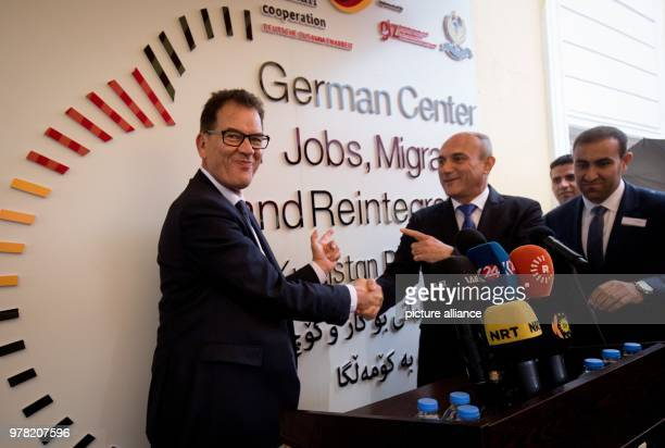 dpatop German Development Minister Gerd Mueller opens a migration advisory center with Iraqi Minister of Planning Ali Sindi in Erbil Iraq 22 April...