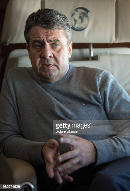 dpatop German Foreign Minister Sigmar Gabriel speaking to the press aboard a German Air Force Airbus A319 in Berlin Germany 14 February 2018 Gabriel...