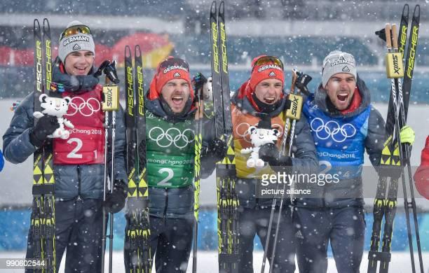 dpatop German gold medallists Vinzenz Geiger Fabian Riessle Eric Frenzel and Johannes Rydzek celebrate after winning the men's team large hill/4 x 5...