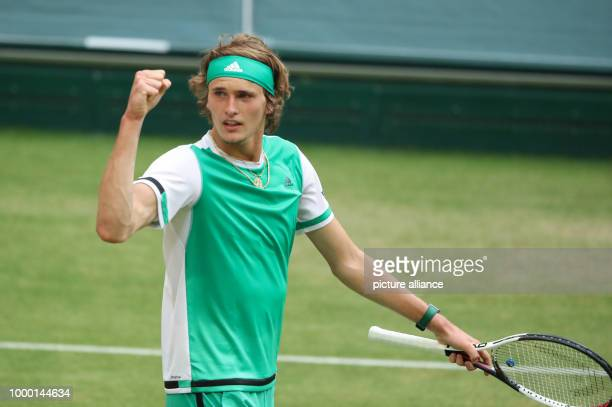 dpatop German tennis player Alexander Zverev cheers over his victory at the ATP tennis tournament men's singles quarter final match against Roberto...