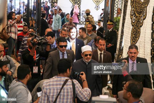 dpatop Grand Imam of alAzhar Ahmed elTayeb arrives to casts his vote on the first day of the 2018 Egyptian presidential elections at a polling...