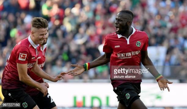 dpatop Hannover's Salif Sane celebrates scoring with team mates Waldemar Anton and Kenan Karaman during the German Bundesliga soccer match between...
