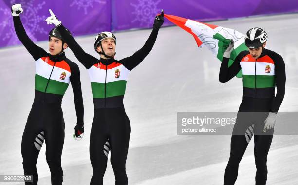 dpatop Hungarian gold medallists Viktor Knoch Shaoang Liu and Csaba Burjan celebrate winning the Men's Short track speed skating 5000 metre relay on...