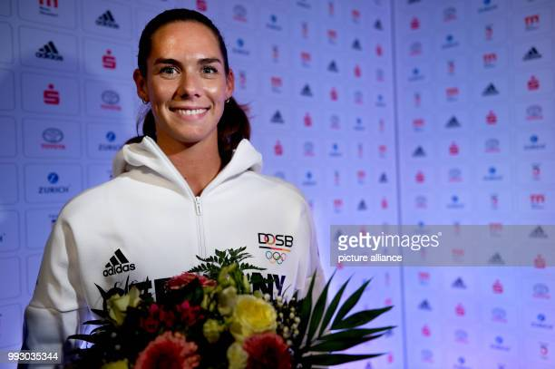 Dpatop - Kira Walkenhorst answers questions during the gear presentation for the future Olympic games in Pyeongchang, in Duesseldorf, Germany, 2...