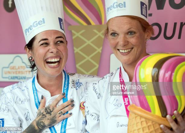 dpatop Linda Peterlunger and Manuela Strabler of Eismanufaktur Kolibri in Wolfurt Austria celebrate winning with their ice cream made of yoghurt...
