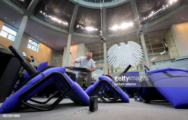 dpatop Men work on the allocation of seats in the plenary hall of the German Parliament in Berlin Germany 17 October 2017 The seating had to...