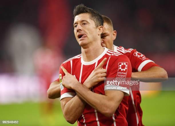 dpatop Munich's Robert Lewandowski celebrates after scoring during the German Bundesliga soccer match between FC Bayern Munich and RB Leipzig at the...