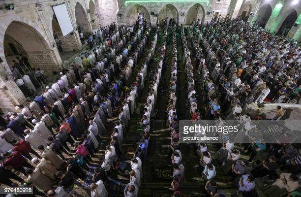 dpatop Palestinian Muslims take part in the evening prayer of 'Laylat alQadr' or the Night of Decree in which Muslims commemorate the revelation of...