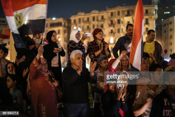dpatop People wave flags of Egypt during celebrations after the reelection of Egyptian President AbdelFattah alSisi for a second fouryear term at...