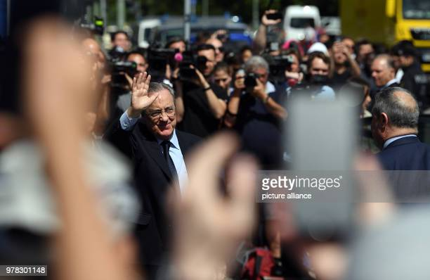 dpatop President of Spanish Real Madrid club Florentino Perez waves to supporters as he arrives with team bus at the hotel ahead of their UEFA...