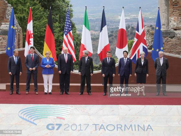dpatop President of the European Council Donald Tusk poses next to Canada's Prime Minister Justin Trudeau Germany's Chancellor Angela Merken US...