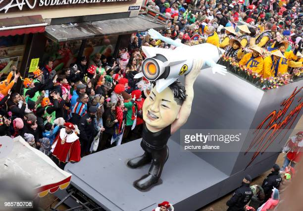 dpatop Revellers celebrate around a mock float featuring a figure of North Korean leader Kim Jongun during the annual Rose Monday carnival in...