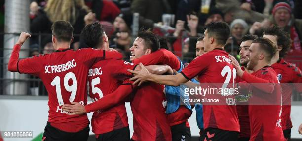 dpatop SC Freiburg and RB Leipzig face off in a Bundesliga match at Freiburg/Breisgau Germany 20 January 2018 Freiburg celebrates its 20 Due to the...
