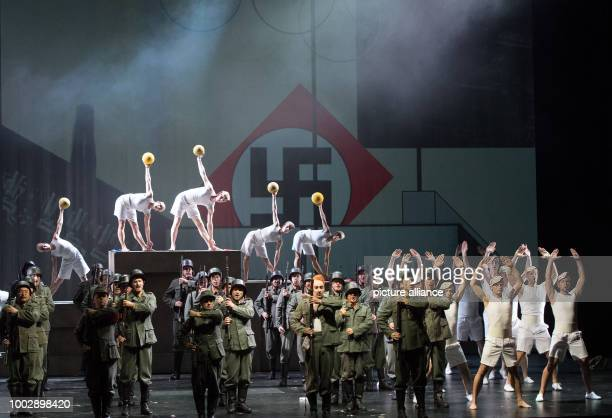 dpatop Tenor Charles Castronovo as Faust and the cast of the State Opera perform during the photo rehearsal of 'La damnation de Faust' a T Gilliam...