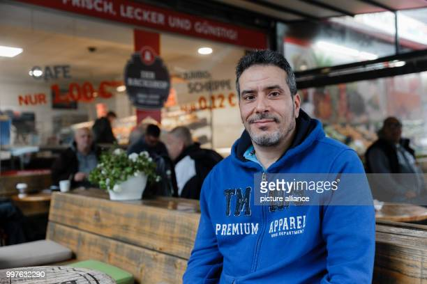 dpatop The Tunisian Jamel Chraie sits in a cafe in HamburgBarmbek Germany 29 July 2017 From here he and others stopped the knife attacker who...