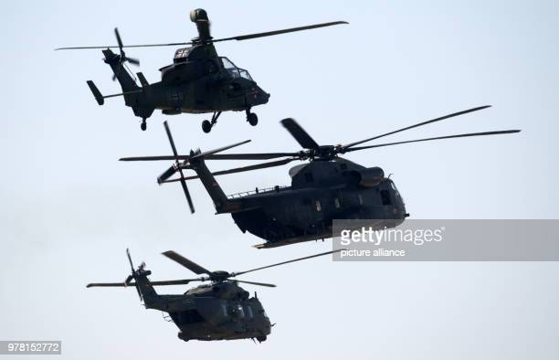 dpatop Three German Bundeswehr helicopters Eurocopter Tiger Sikorsky CH53 Sea Stallion and NHIndustries NH90 fly in formation during a training for...