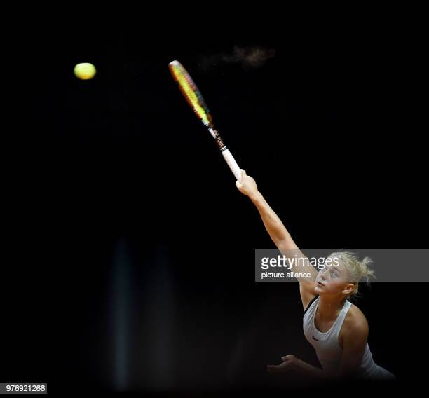 dpatop Ukrainian tennis player Marta Kostyuk returns to French Caroline Garcia during their 2018 Stuttgart Open round of 16 women's singles match...