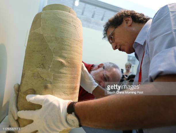 Dr Adolfo Roitman Curator of the Dead Sea Scrolls at The Israel Museum Jerusalem shows the Scroll Jar during media preview of Temple Scrolls and...