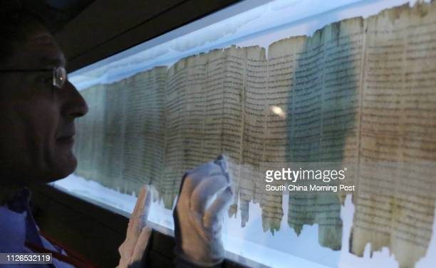 Dr. Adolfo Roitman, Curator of the Dead Sea Scrolls at The Israel Museum, Jerusalem shows the The great Isaiah Scroll at Asia Society Hong Kong...