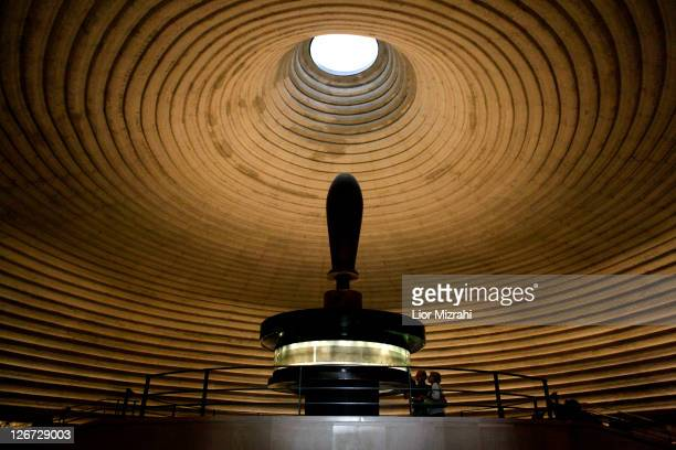 Dr Adolfo Roitman presents a part of the Isaiah Scroll one of the Dead Sea Scrolls inside the vault of the Shrine of the Book building at the Israel...