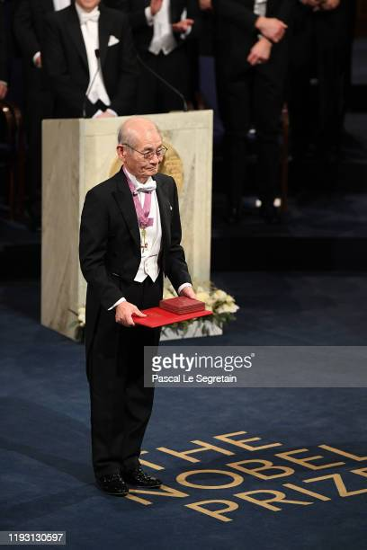 Dr Akira Yoshino, laureate of the Nobel Prize in Chemistry acknowledges applause after he received his Nobel Prize from King Carl XVI Gustaf of...