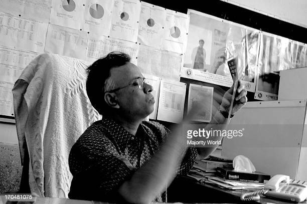 Dr AKM Mushfiqur Rahman Faruq from the National TB Control Project Shamoli Dhaka examines an Xray of a suspected TB patient in his hospital chamber...