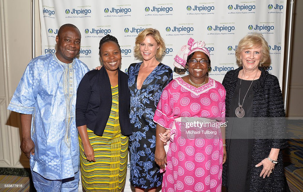 Dr. Alain Damiba, guest, actress Julie Bowen, guest and Dr. Leslie Mancuso attend Jhpiego's 'Laughter Is The Best Medicine' event at the Beverly Wilshire Four Seasons Hotel on May 23, 2016 in Beverly Hills, California.