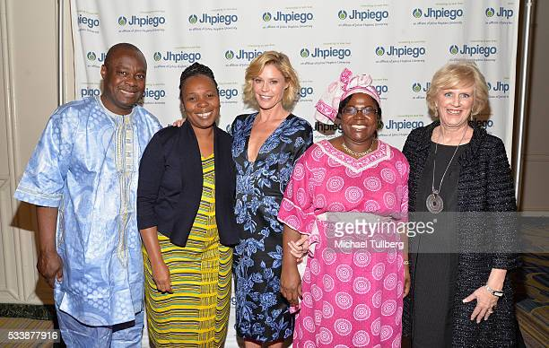Dr Alain Damiba guest actress Julie Bowen guest and Dr Leslie Mancuso attend Jhpiego's 'Laughter Is The Best Medicine' event at the Beverly Wilshire...