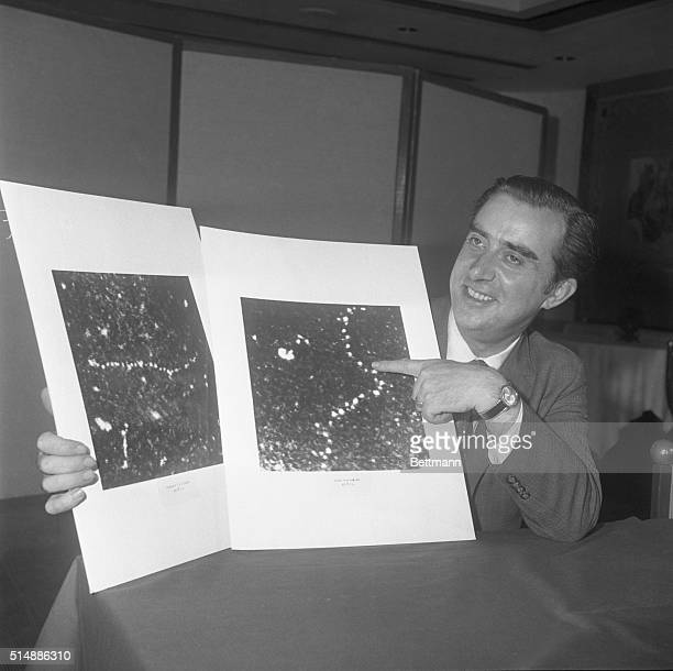 Dr Albert V Crewe a professor in the University of Chicago's department of physics and the Enrico Fermi Institute displays 5/20 a photograph of...