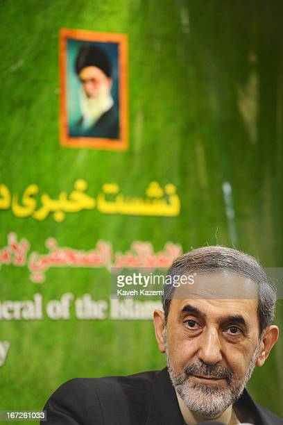 Dr. Ali Akbar Velayati the chairman of the Islamic Awakening Assembly participates in a press conference with a photo of Iran's supreme leader...
