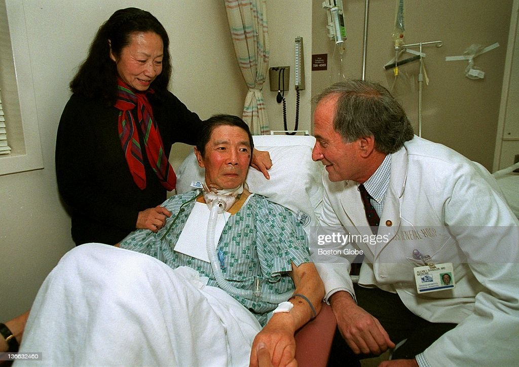 Dr  Allan Sandler, right, visits in his Mass General Hospital room