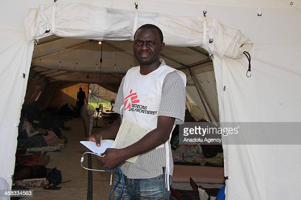 Dr Amicet Choudja of MSF gets ready to attend treatment of injured patients at the MSF center following the sectarian clashes on December 20 2013 in...