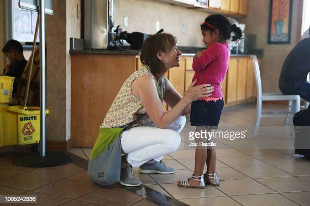 Dr Amy Anixter Scott speaks with Maria at an Annunciation House facility after she was reunited with her father on July 25 2018 in El Paso Texas...