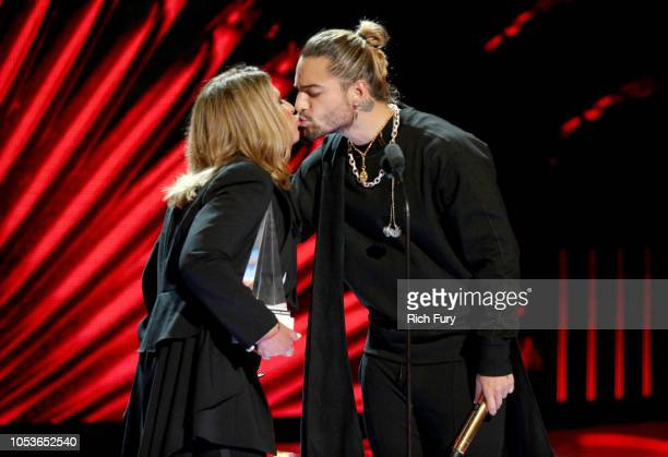 Dr Ana Maria Polo presents the Extraordinary Evolution Award to Maluma onstage during the 2018 Latin American Music Awards at Dolby Theatre on...