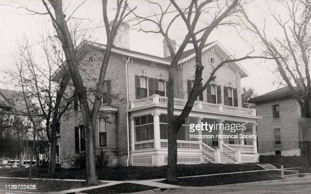 Dr and Mrs Philip R and Katherine B Fox residence at 28 West Wilson Street corner of South Carroll Street Madison Wisconsin 1910 The house was...