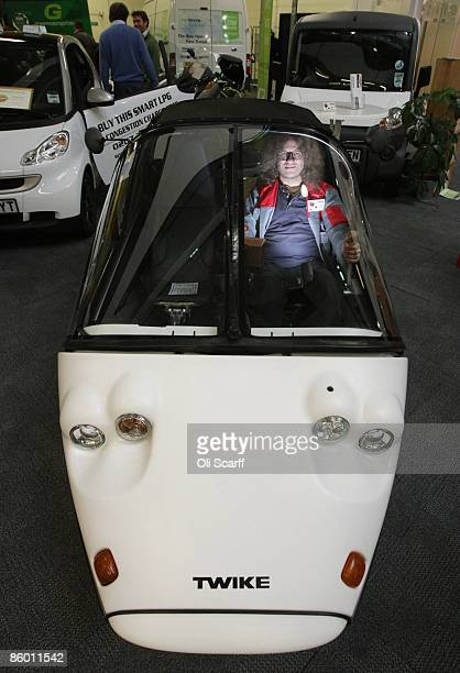 Dr Andreas Schroeer the UK importer for Twike sits in the Twike Easy electric car at UK Aware the UK's only green lifestyle exhibition for people...