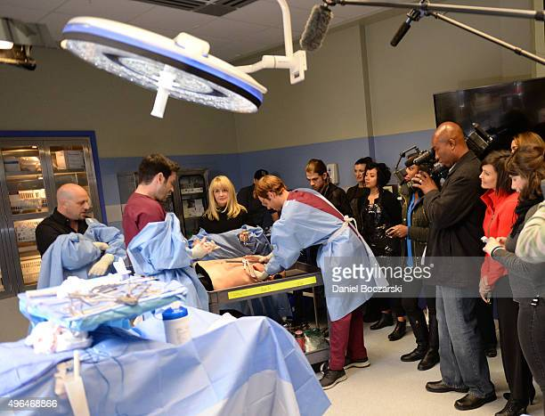 """Dr. Andrew Dennis and Susie Schelling consult actors Colin Donnell and Nick Gehlfuss as they perform an on set demonstration of """"Chicago Med"""" during..."""