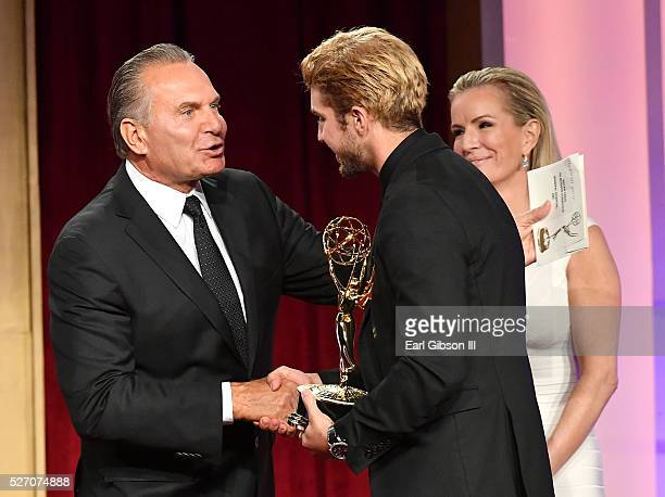 Dr Andrew P Ordon MD and physician Jennifer Ashton present Actor Bryan Craig an Emmy for Outstanding Younger Actor in A Drama Series on stage at the...