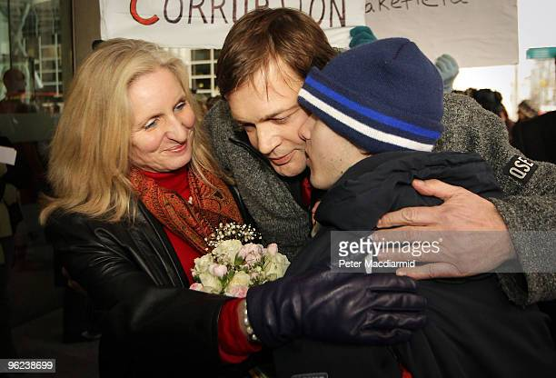Dr Andrew Wakefield and his wife Carmel are given a hug by 17 year old Josh Edwards who is autistic outside the General Medical Council on January 28...
