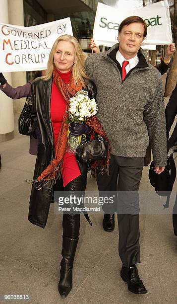 Dr Andrew Wakefield walks with his wife Carmel after speaking to reporters at the General Medical Council on January 28 2010 in London England Dr...
