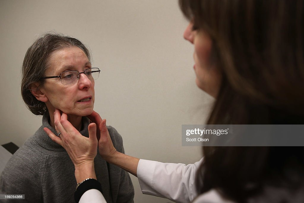 Dr. Anne Furey Schultz examines a patient complaining of flu-like symptoms at Northwestern Memorial Hospital on January 10, 2013 in Chicago City. According to the Centers for Disease Control and Prevention flu is widespread in 41 states. The CDC has reported 22,048 flu cases from Sept. 30 through December 31, 2012 compared with only 849 for the same period last year.