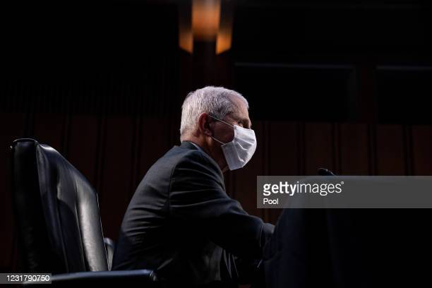 Dr. Anthony Fauci, Director at the National Institute Of Allergy and Infectious Diseases, listens during a hearing with the Senate Committee on...